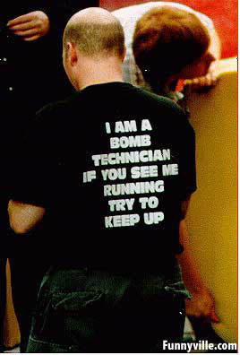 A bomb technician wears funny shirt